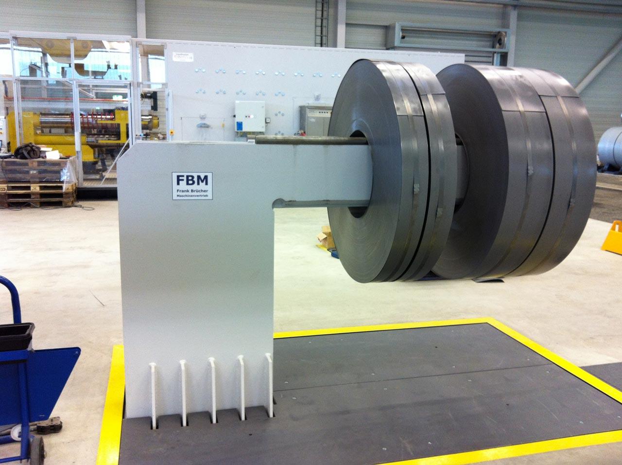 Coilständer, coilumreifung, coil station, hängende Coilstation, Coil hängend, coil stand, coil exportverpackung, coil abbindestation, Coilwaage